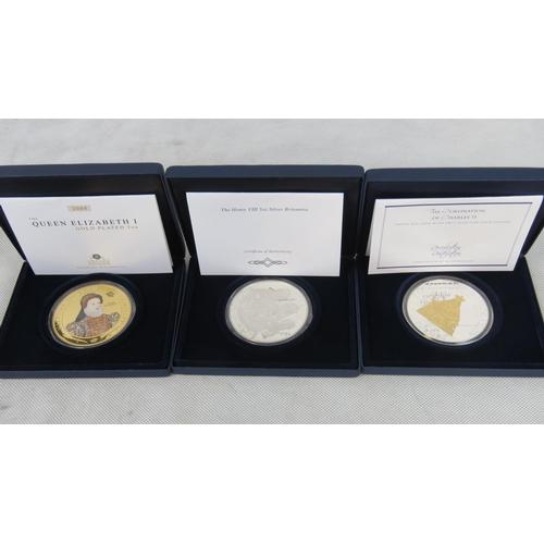 301 - A Henry VIII Britannia silver commemorative coin, 4.56ozt, A Charles II commemorative silver coin, 4...