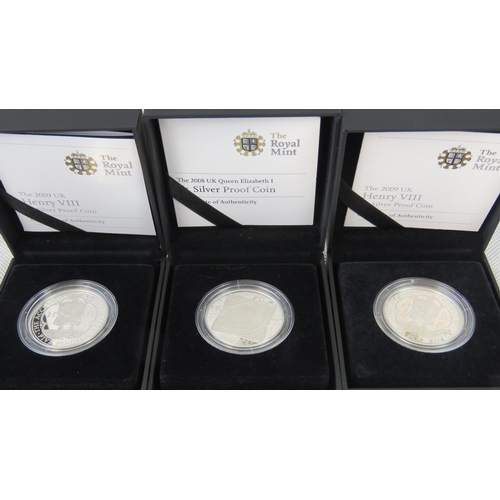 302 - Two Royal Mint Henry VIII silver proof coins, face value, issued 2009, in presentation case. Also Qu...