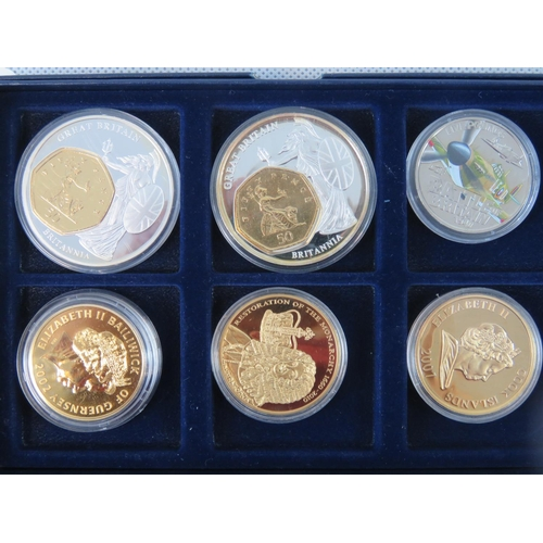 305 - A six part gilded commemorative coins including Cook Islands 2001 $1 and Guernsey 2010 £5...