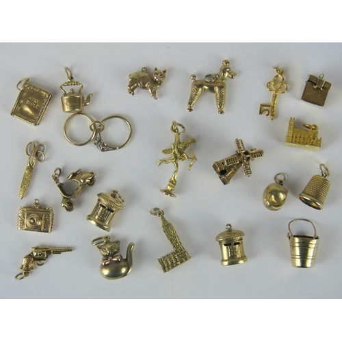 103 - Twenty-one 9ct gold charms; windmill, thimble, two postboxes, cupid, Big Ben, Rings, scissors, First...
