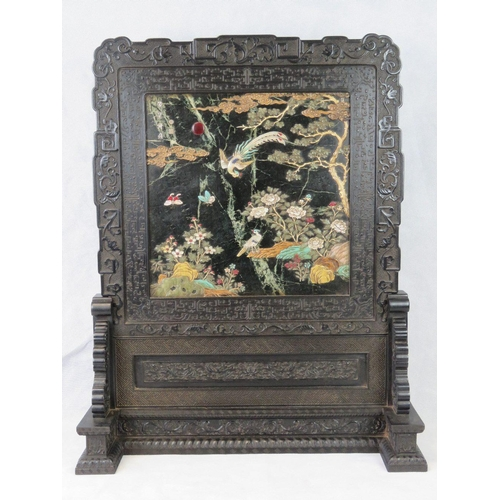 659 - A magnificent Oriental hardwood table screen profusely carved throughout. The Jade screen bearing Or...