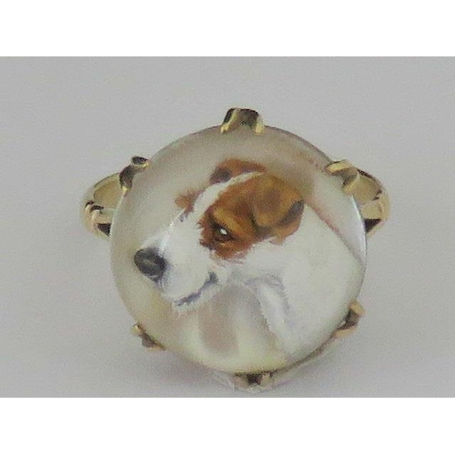 413 - A 9ct gold painted reversed crystal intaglio Terrier ring made by  Ernest.M. Pradier (1881-1967). Th...