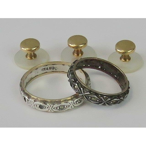 414 - Two 9ct gold and silver eternity rings, each set with white stones, together with a boxed set of thr...