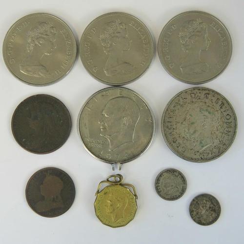 600 - Coins; a George VI 1937 half silver crown, a  George V 1932 South Africa 3d, a George VI 1940 3d, an...