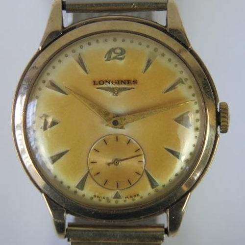 651 - A 9ct gold Longines wristwatch on gold plated expanding bracelet, manual wind 17 jewel movement No89...