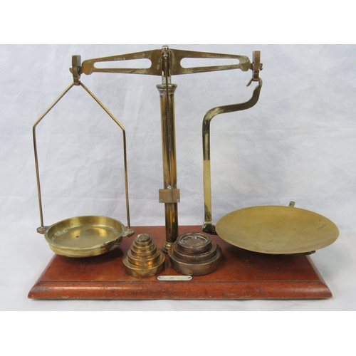 862 - A set of early 20th century apothecary scales mahogany base and brass fittings together with three '...