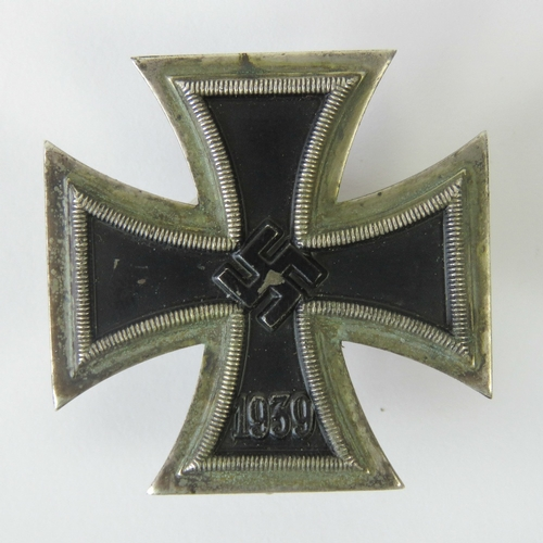 1 - A WWII German Iron Cross 1st Class, pin stamped '20'....