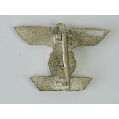 16 - A WWII German Iron Cross bar stamped 'A' to back....