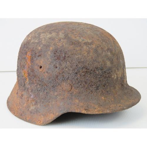 18 - WWII German helmet, battlefield relic....