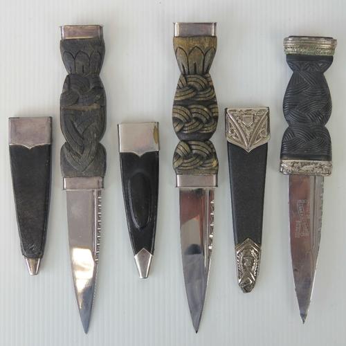 2 - Three Scottish Sgian Dubh knives, complete with scabbards with white metal fittings. One with orange...