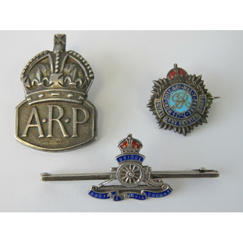 21 - Two WWII silver sweetheart badges, one for Royal Artillery stamped Sterling, and one for Royal Army ...