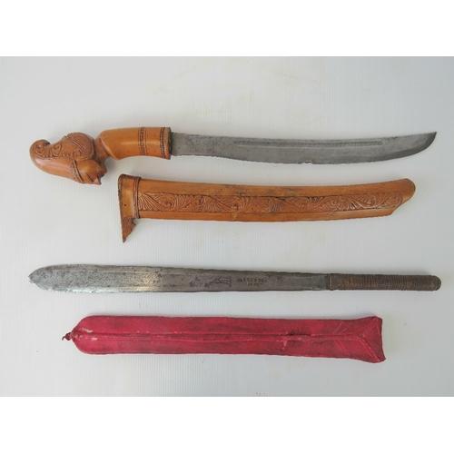 30 - An African mid 20th century Maasai Seme Short Sword, blade length approx. 39 cm. 'Brades 1652' mark ...