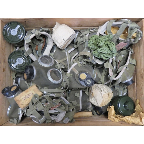 6 - A quantity of Soviet/Hungarian gas masks, in original packaging, unissued, forty in original crate....