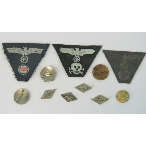 7 - A quantity of reproduction WWII cloth and metal badges. 11 in total....