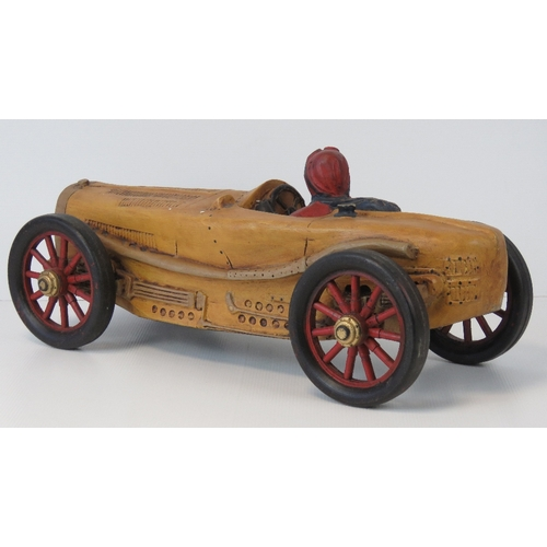 21 - A contemporary decorative model of a vintage racing car with driver, 55cm....