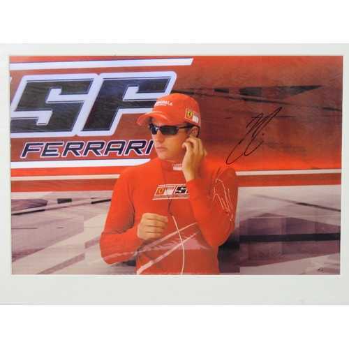 18 - A signed coloured photograph of Kimi Raikkonen, Ferrari, mounted, with certificate, 29cm x 44cm....