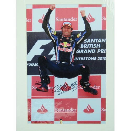 43 - A signed coloured photograph of Mark Webber, 'The Jump' at F1 British GP, Silverstone 2010, with cer...