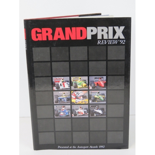 7 - Book; Grand Prix Review 1992, hardback with dust wrapper, signed by Nigel Mansell....
