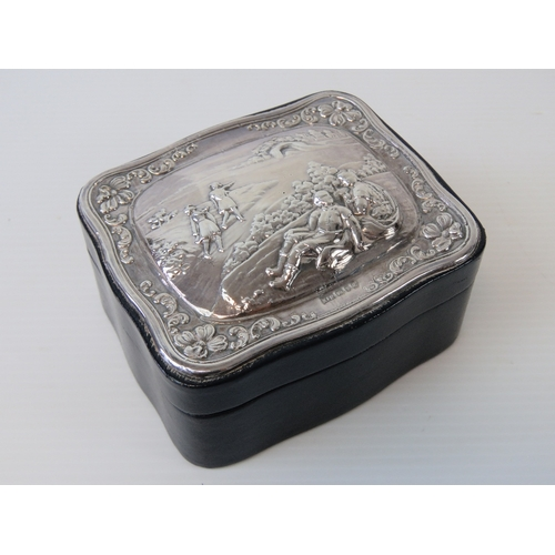 1 - A delightful HM silver and leather trinket box having suede lining, the silver top depicting rural s...