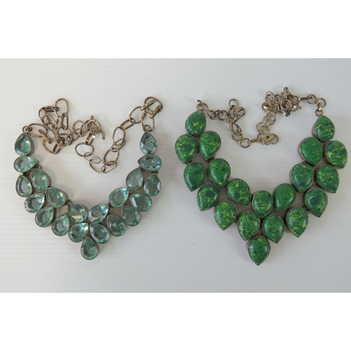 108 - Two white metal handmade necklaces, one set with green hardstone cabachons, the other with aquamarin...