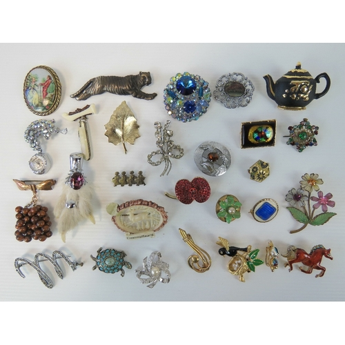 117 - A quantity of assorted 20th century brooches including; a fob watch by Sambra, floral examples, rabb...