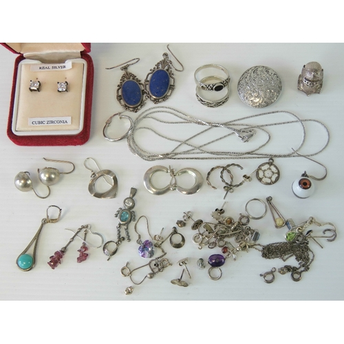 136 - A quantity of assorted silver and white metal jewellery including; floral engraved lapel stud, earni...