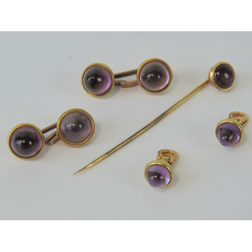 139 - An amethyst and yellow metal set of cufflinks, tie pin and collar studs. Total weight 22.2g....