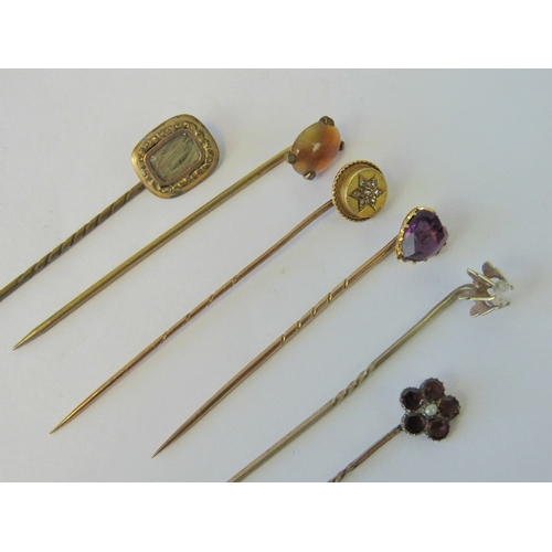 107 - A 15ct gold and diamond stick pin, together with five other vintage yellow metal stick pins includin...
