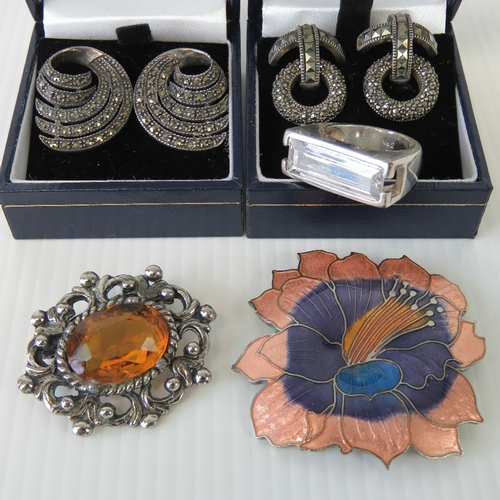 114 - Two pairs of 925 silver and marcasite earrings, together with two costume jewellery brooches and a r...