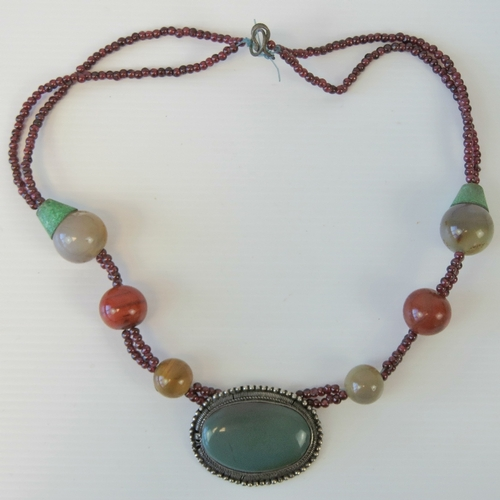 116 - A handmade hardstone necklace, central white metal panel, approx 5cm wide, having inset green oval c...