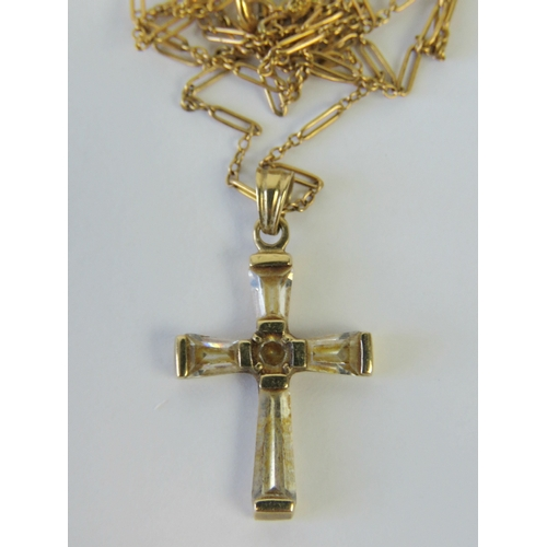 129 - A 9ct gold cross having inset white stones, stamped 375, on 9ct gold fancy link chain, stamped 9c. T...