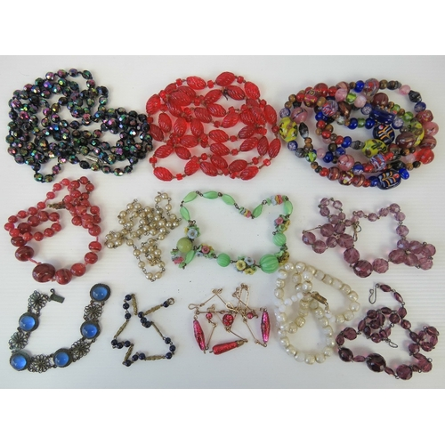 131 - A quantity of assorted vintage glass bead necklaces including a hand painted example, faux pearls, a...