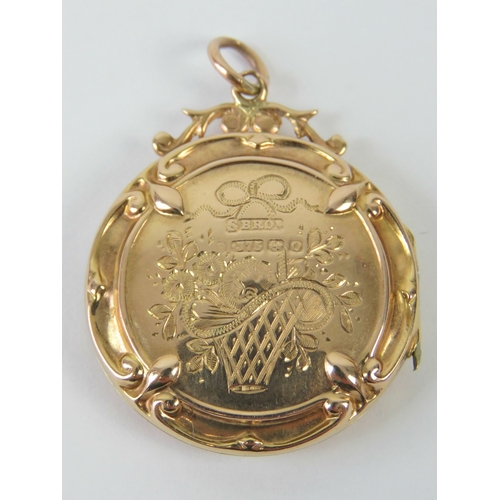 111 - A Victorian 9ct gold locket of circular form having engraved bow with floral swag to front and furth...