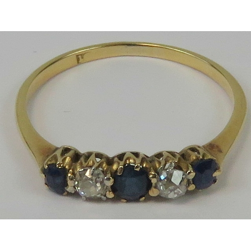 115 - An 18ct gold diamond and sapphire ring, three graduated sapphires of good royal blue colour, separat...