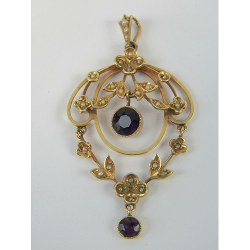 119 - A delightful Edwardian 9ct seed pearl and amethyst pendant of floral form having articulated swag wi...
