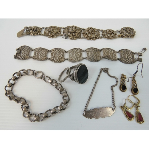 138 - Two white metal filigree bracelets, together with a white metal and bloodstone ring, a Sterling silv...
