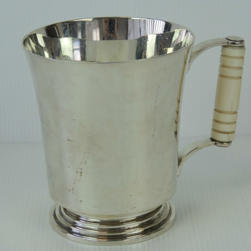 5 - A HM silver tankard having turned ivory handle, hallmarked Birmingham 1935 having makers and retaile...