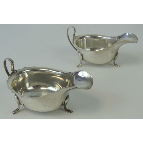 8 - A pair of HM silver sauce boats having pie crust edge and raised over three outswept feet, hallmarke...
