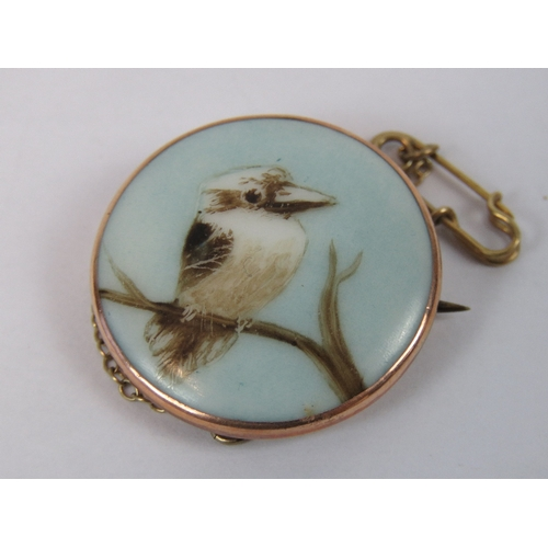 135 - A delightful 9ct gold brooch having central circular ceramic plaque with hand painted hand painted K...