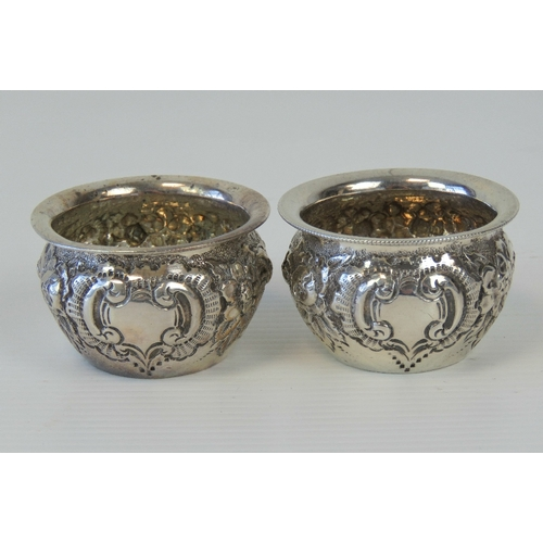 17 - A pair of HM silver floral repoussé salts, hallmarked Chester 1897 with Colen Hewer Cheshire makers ...