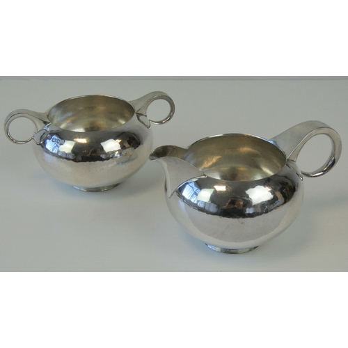 18 - A HM silver sugar bowl and matching HM silver jug, having graduated loop handles, jug 14.5cm wide, b...