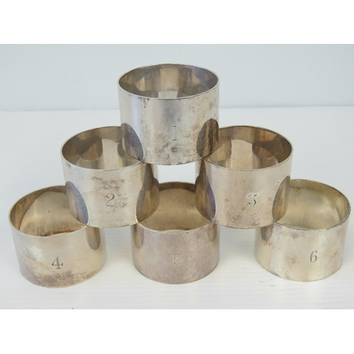 19 - A set of six HM silver napkin rings, engraved 1 - 6, hallmarked Birmingham 1929 with Docker & Burn L...