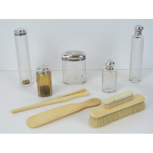 9 - A set of five HM silver and cut glass dressing table bottles including  hat pin pot, scent bottle, a...