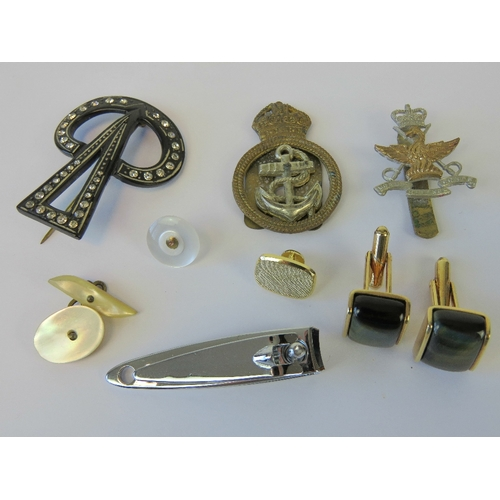 131 - Two cap badges; one Mobile Defence Coprs and one Naval. Together with a pair of cufflinks, a vintage...