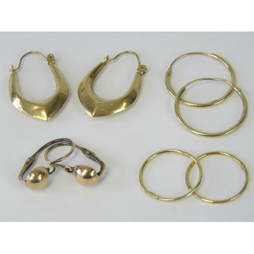 121 - Four pairs of yellow metal earrings; two pairs of training hoops, a pair of hinged back earrings, an...