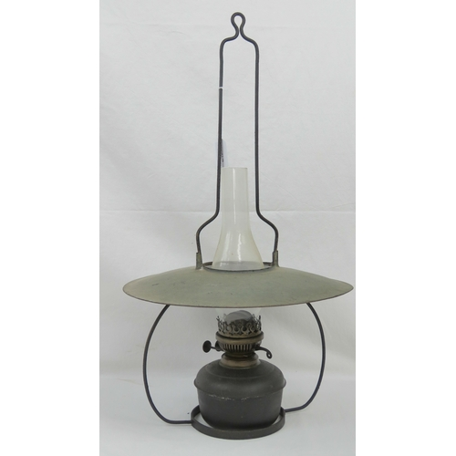 403 - A vintage hanging oil lamp complete with shade and chimney....