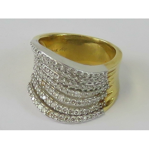 103 - An impressive 18ct gold and diamond cocktail ring having seven separated undulating rows encrusted w...