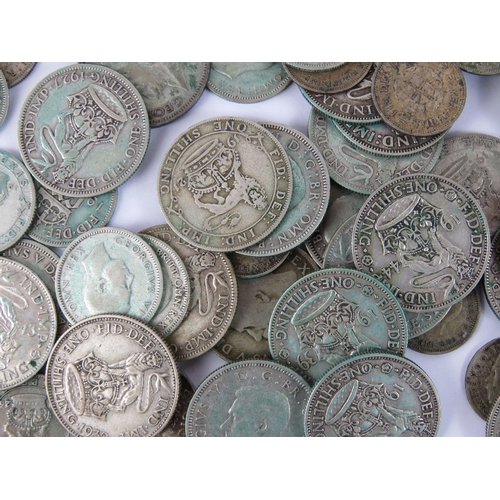 302 - A quantity of half silver (c1920-1946) coinage including shillings, six-pence, and three-pence coins...
