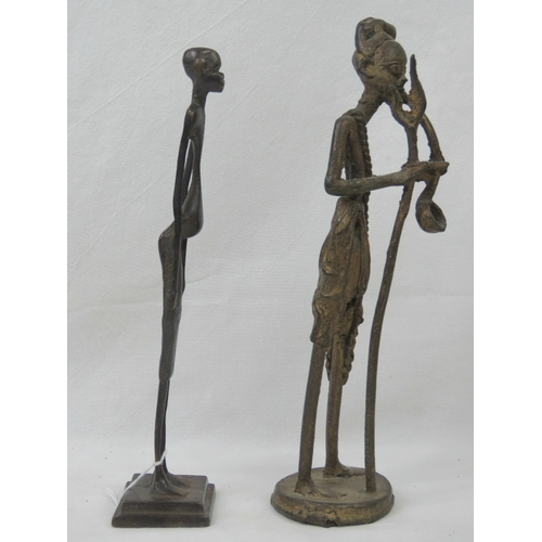 420 - Two cast metal stylised African figurines, each standing around 29cm high....