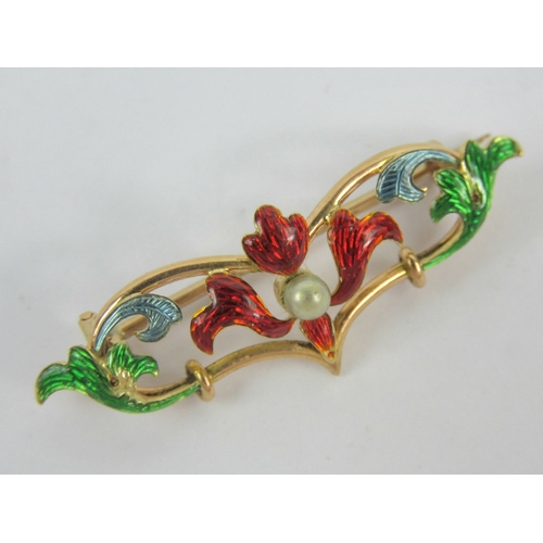 114 - An Art Nouveau brooch of floral form having multicoloured enamelling and central seed pearl, no appa...